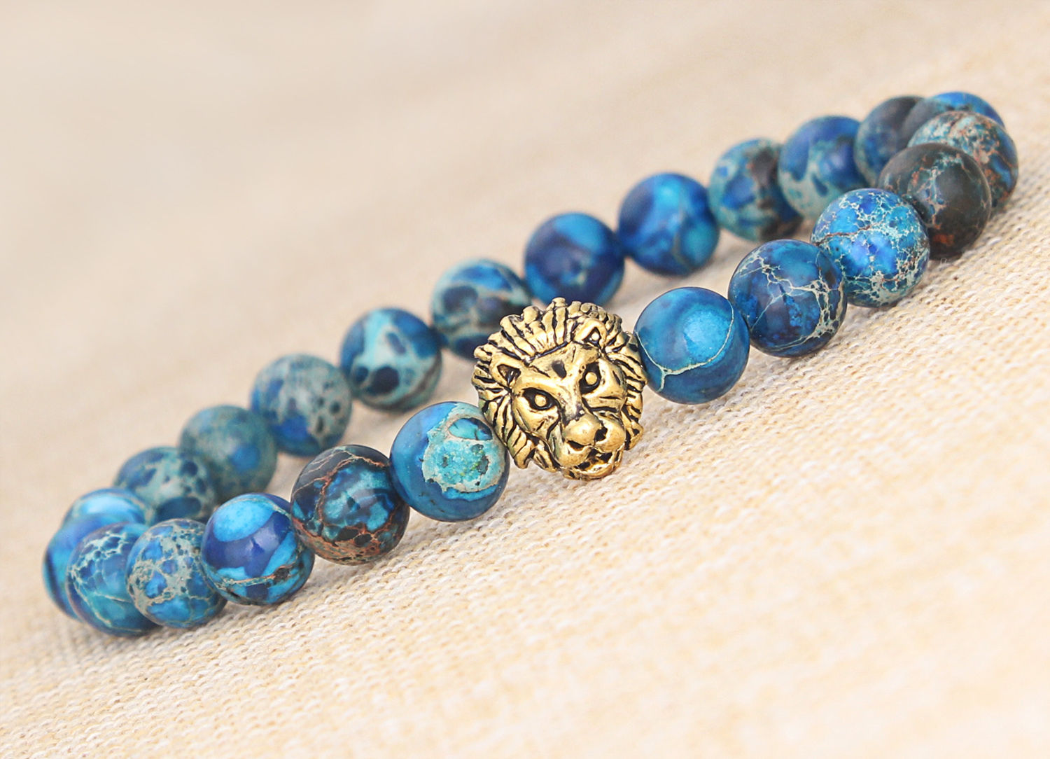 Blue Sea Sediment Jasper Stone Gold Lion Bracelet 8 In